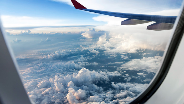 How to Minimize Jet Lag When Crossing Time Zones to Race